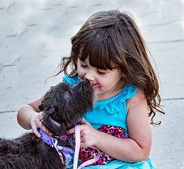 black-dog-beside-little-girl_edited.jpg