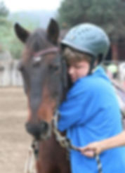 Student in therapeutic riding, horse therapy, special needs
