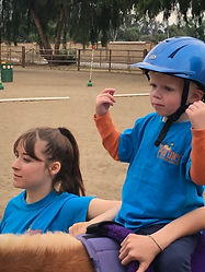 Hayden A rider at Partners Therapeutic Horsemanship