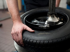 bigstock-Tire-Change-Closeup-5764847.jpg