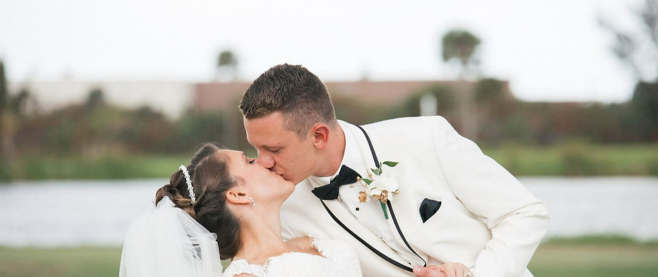 Bride + Grom kissing | Eventful Moments by Cindy
