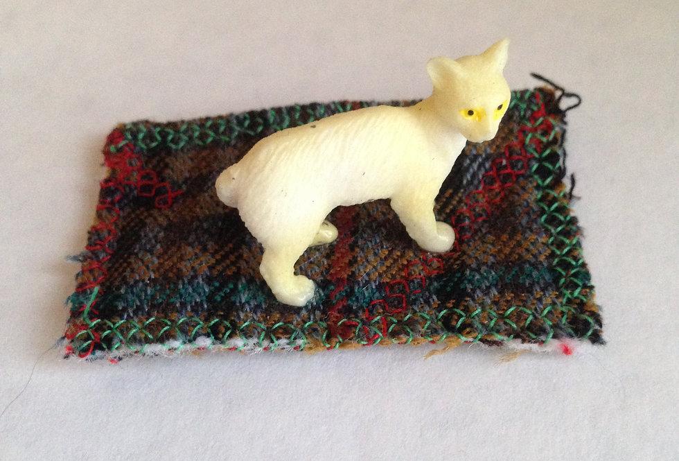 Large White cat on Plaid Rug