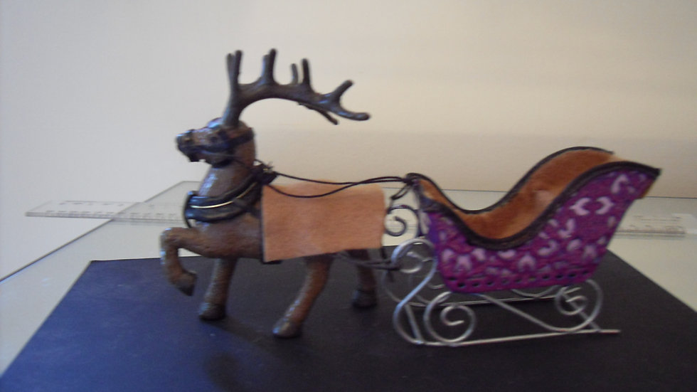 Handmade 1/24th scale reindeer and sleigh.