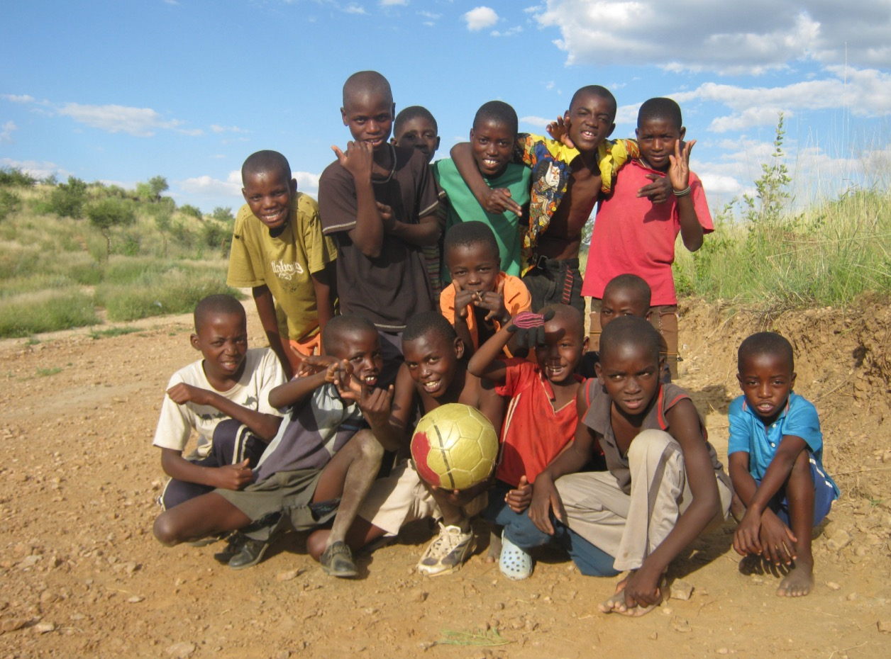Kids playing ball in Africa