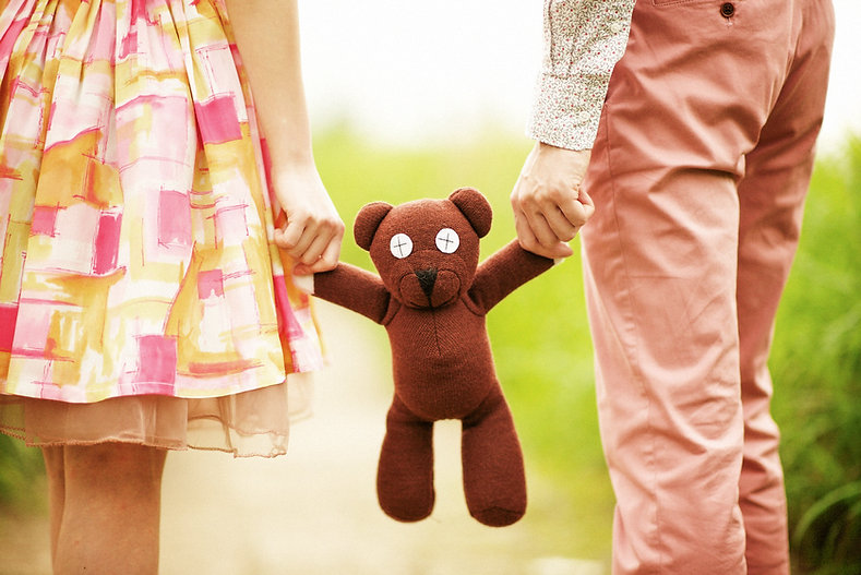 Engagement photo, detail shot of teddy bear