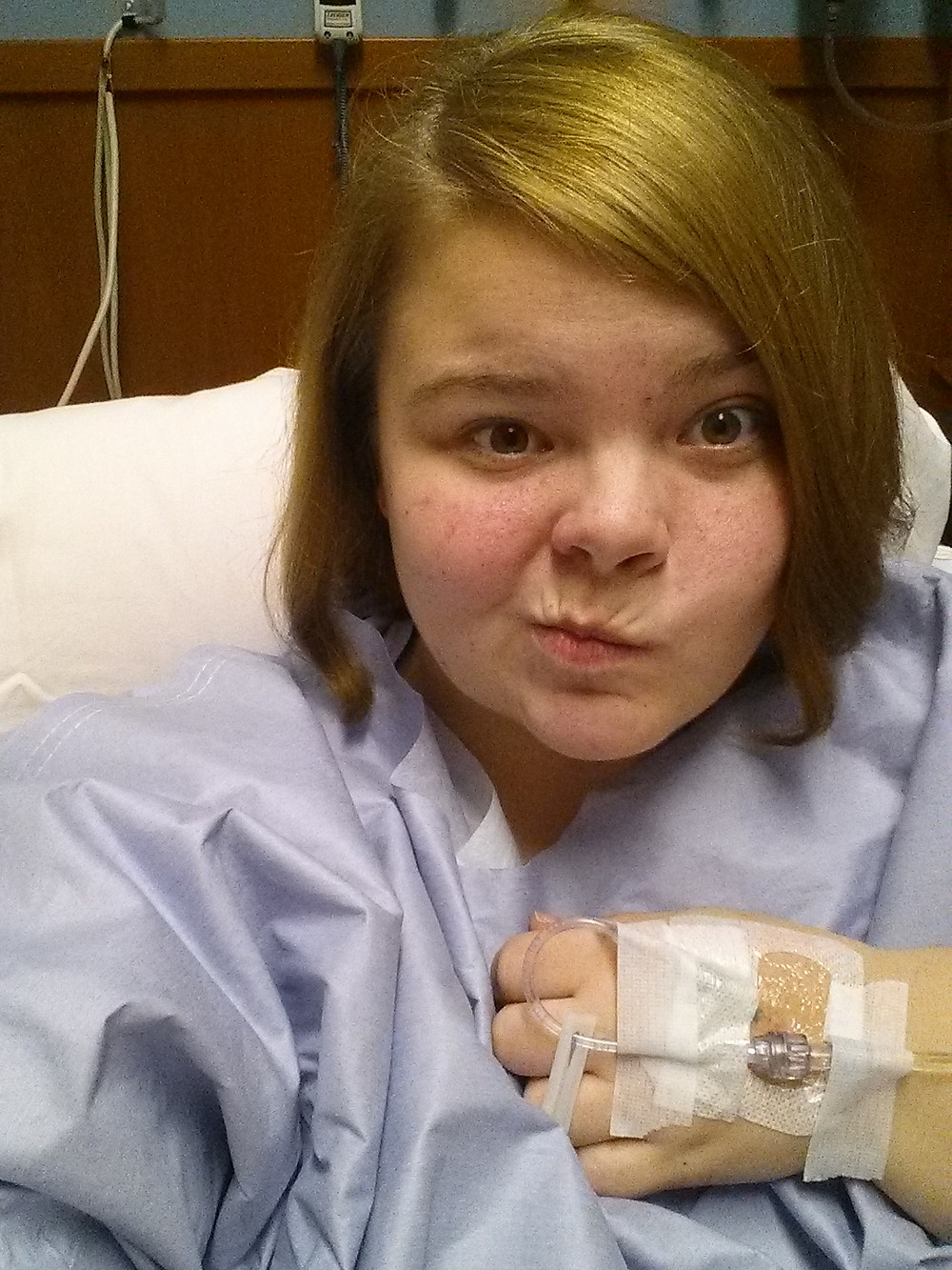 Hospital selfie showing IV in hand.