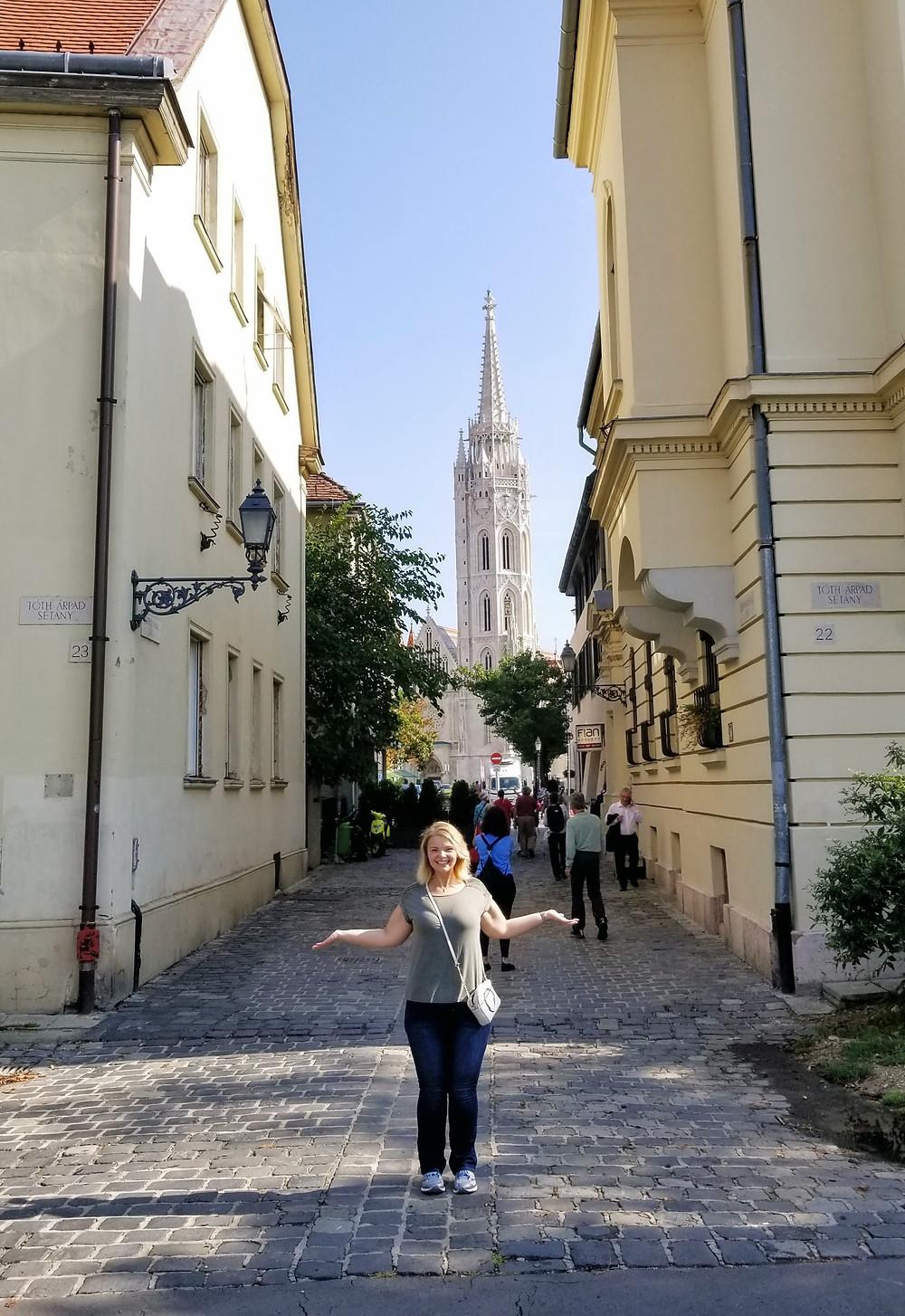 Kayla standing in front of Saint Matthias Church on Buda Hill
