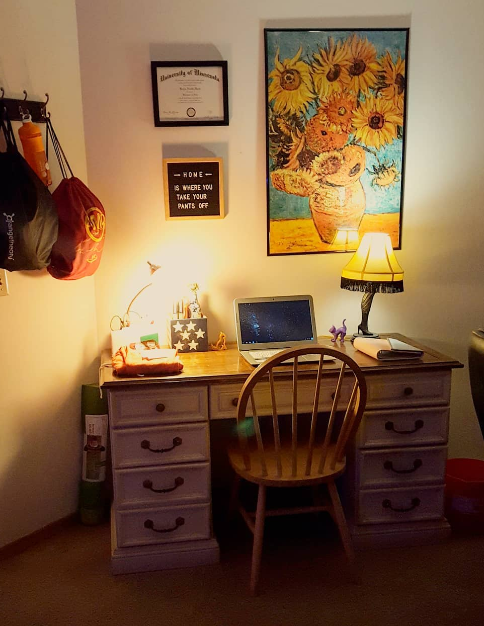 Kayla's clean desk, well decorated and lit.