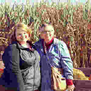 Kayla and her mom, in front of a field of corn.