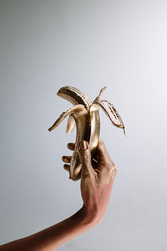 photo-of-person-holding-gold-banana-4631