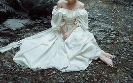 ella sitting in the forest.jpg