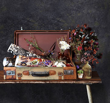 vintage suitcase with wallpaper rolls by Good & Craft