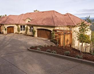 Beautiful custom home sitting at base of driveway.