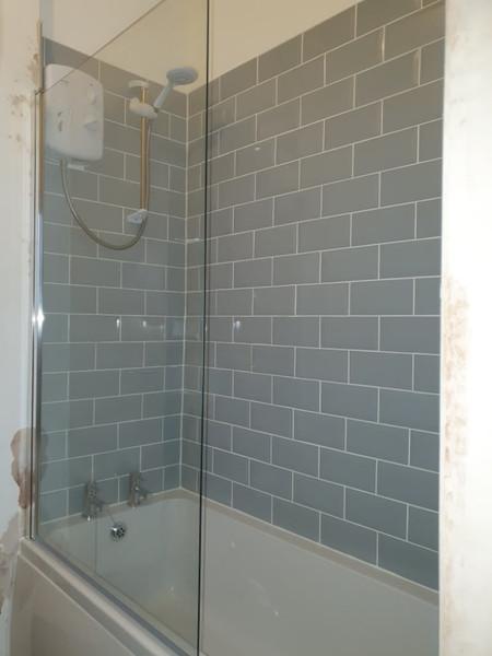 bath shower with grey brick tiling