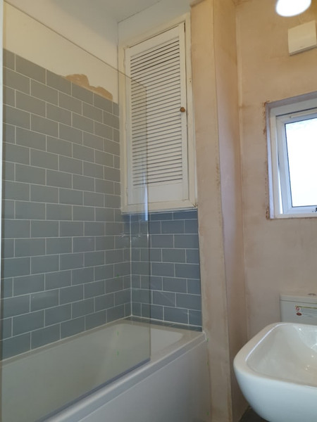 bathroom with grey tiles