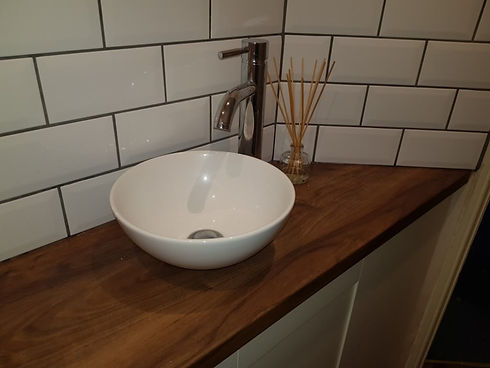 Bathroom modern sink with white tiles and black grout background