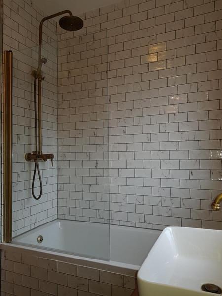 shower bath with brick white tiles