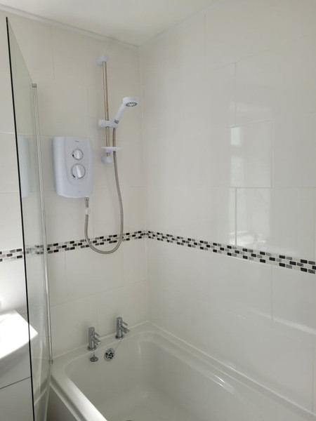 bath shower with patterned tiles