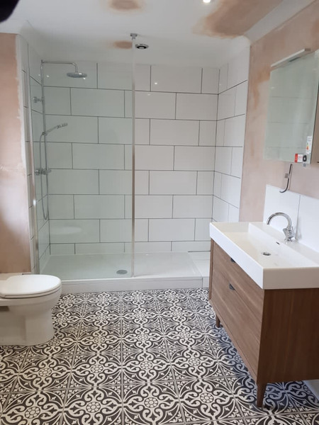 bathroom with patterned flooring
