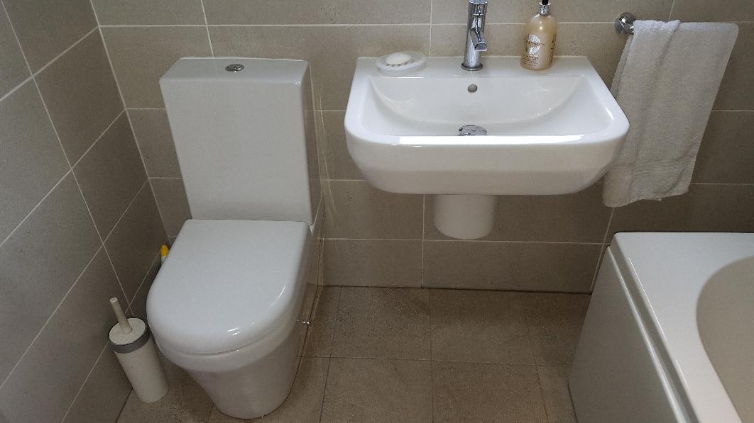 small bathroom with grey tiles