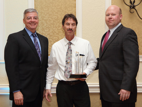 Aerodyne Industries LLC presents Florida President's Award to Titusville's Paul Espy