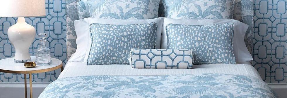 Custom Headboard with Matching Shams, Bolster Pillows and a Bed Runner. Courtesy of Kravet