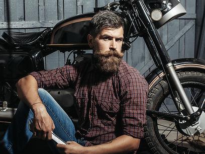 Bearded man hipster biker brutal male wi