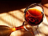 A glass of brandy with the sun shining through it