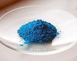 a photo of copper sulphate in a glass dish