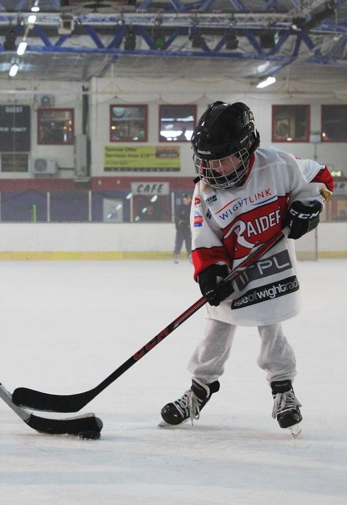 Emily playing hockey