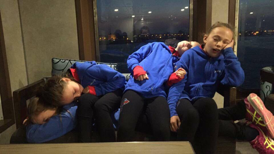 Four of the Wight Sparkles sleeping on a ferry home from Gosport after a 3am start