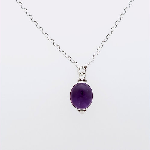 Amethyst pendant with silver accents