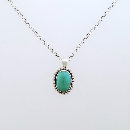 Small Turquoise Pendant with silver accents