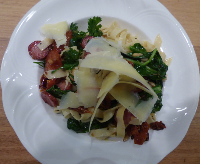 Pasta with Amber Creek cabana, wilted rocket and dried tomatoes.