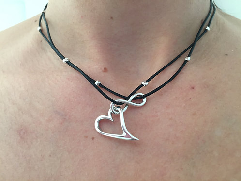 Sterling silver necklace in a string with silver-beats
