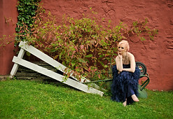 Doreen Taylor poses against the back exterior of Oscar Hammerstein's former home in Doylestown, PA