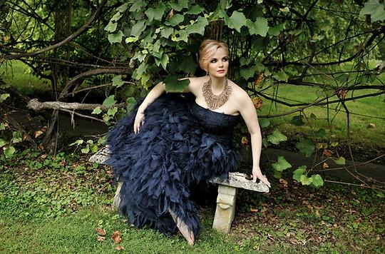 Doreen Taylor sits beneath an arbor at the former Pennsylvania home of Oscar Hammerstein