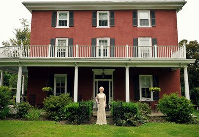 Doreen Taylor poses in front of the former home of lyricist and librettist Oscar Hammerstein II in Doylestown, PA