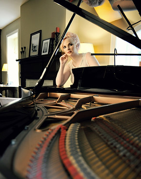 Doreen Taylor sits behind the piano gracing the living room where Oscar Hammerstein spent time with his family during the most productive period of his life