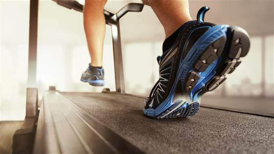 Someone running on a treadmill during an exercise echo