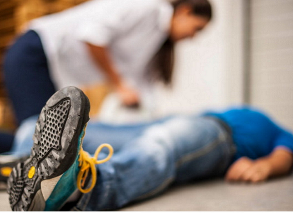 man has fallen to the ground and passed out (syncope)