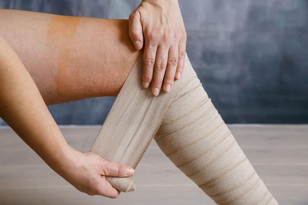leg wrapped in ace bandage