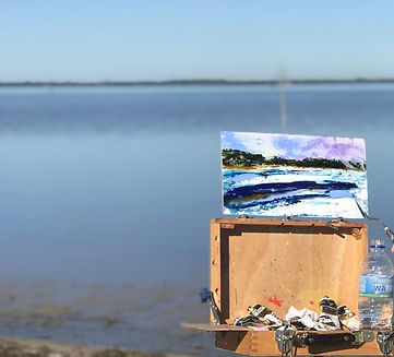 working easel overlooking a lake