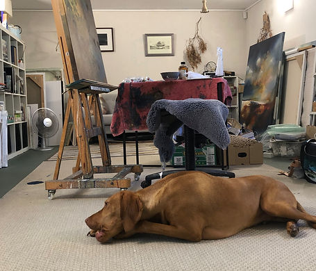 Joanne Duffy's painting studio wth her Hungarian Viszla dog in the foreground