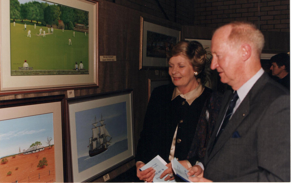 Historical image of Army Art founder Maureen and her husband Neville Smethurst at an exhibition enjoying the Australia Artwork