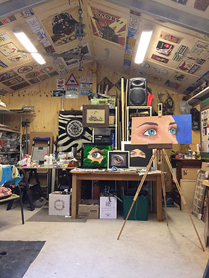 Artist Andy Wilkinson shares his art studio with his themed paintings of eyes