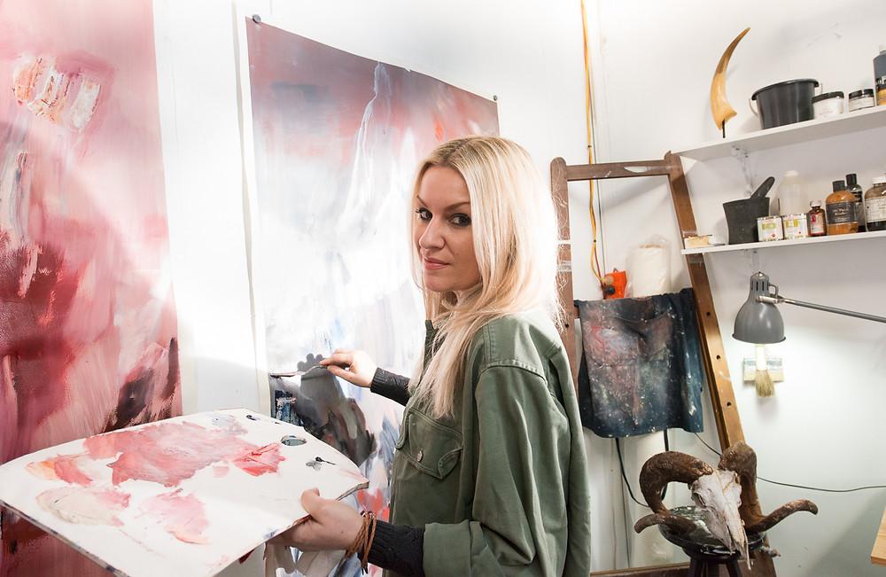 Stephanie Reisch painting in her studio Army Art interview