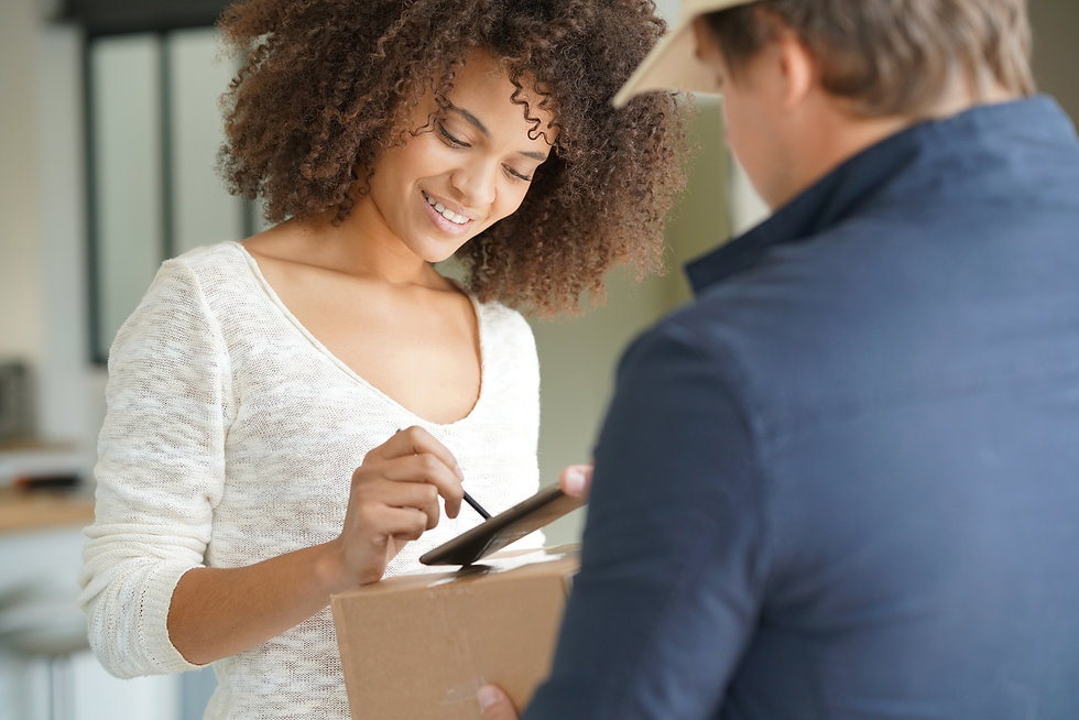 Mixed race woman receiving package from
