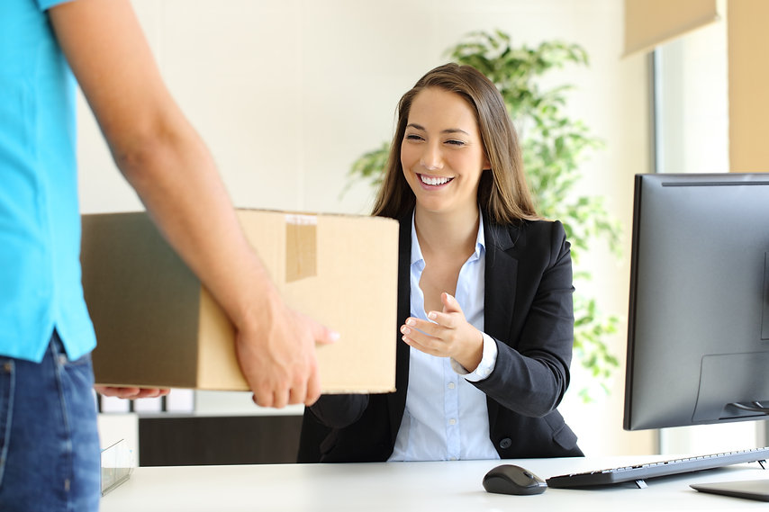 Happy businesswoman receiving a package