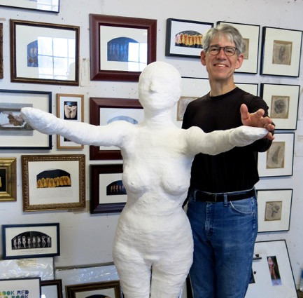 Matt Marcontell dances with a plaster cast of his dancer wife Rebecca